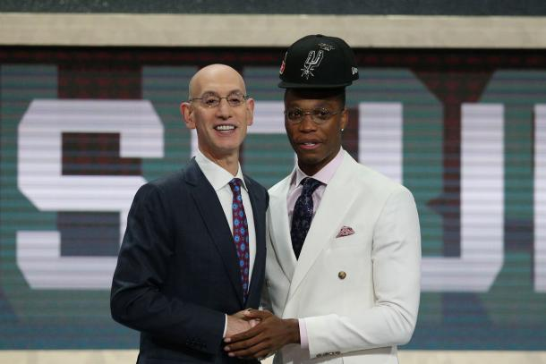 Lonnie Walker IV (Miami) greets NBA commissioner Adam Silver after being selected as the number eighteen overall pick to the San Antonio Spurs in the first round of the 2018 NBA Draft. |Brad Penner-USA TODAY Sports|
