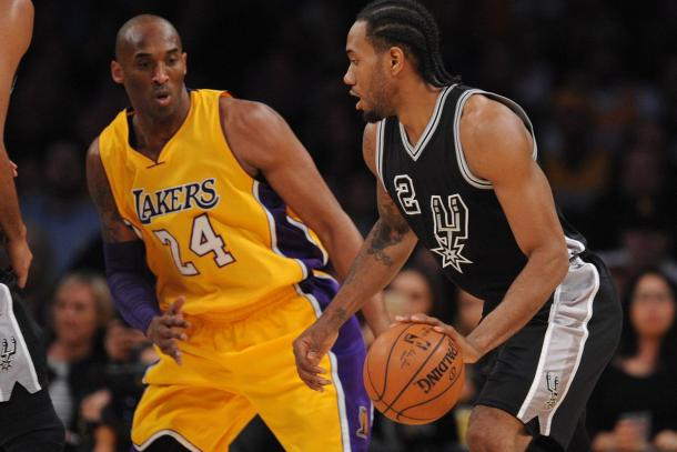 January 22, 2016; Los Angeles, CA. Kawhi Leonard (2) of the San Antonio Spurs driving against Los Angeles Lakers forward Kobe Bryant (24). |Gary A. Vasquez-USA TODAY Sports|