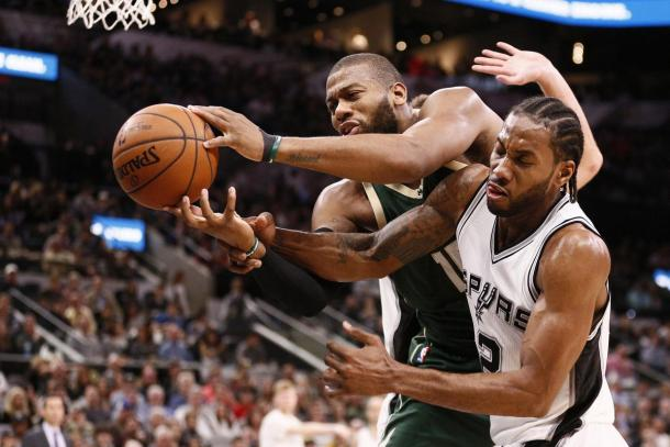 Center Greg Monroe (15, left) and former San Antonio Spurs small forward Kawhi Leonard (2, right) will know be teammates in Toronto. |Soobum Im-USA TODAY Sports|