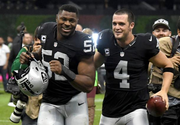 Khalil Mack and Derek Carr celebrate after a NFL International Series game against the Houston Texans at Estadio Azteca |Nov 21, 2016, Source: Kirby Lee-USA TODAY Sports|