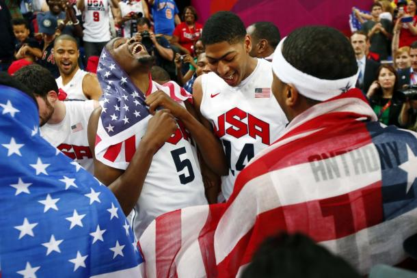 USA players Kevin Durant (left) , Anthony Davis (middle), and Carmelo Anthony (right) after defeating Spain 107-100 during the men's basketball gold medal game in the London 2012 Olympic Games |Rob Schumacher-USA TODAY Sports|