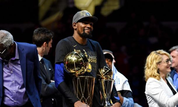 Golden State Warriors forward Kevin Durant (35) celebrates with the Bill Russell NBA Finals Most Valuable Player Award and the Larry O'Brien Championship Trophy after beating the Cleveland Cavaliers in game four of the 2018 NBA Finals at Quicken Loans Arena. |Kyle Terada-USA TODAY Sports|