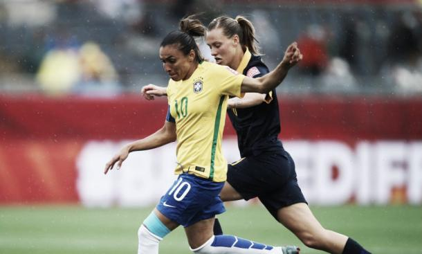 van Egmond (right) battles with Marta in Australia's historic Round of 16 win - Brazil at the 2015 FIFA Women's World Cup. Photo: Getty Images
