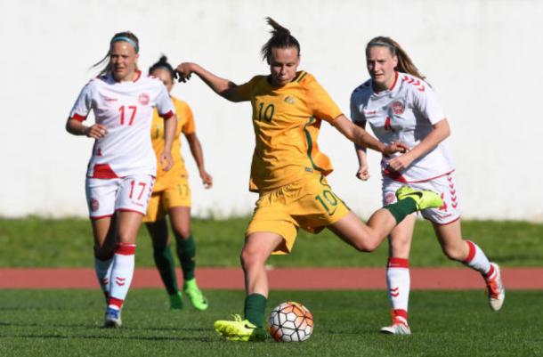 Australian midfielder Emily van Egmond sends the ball in a match against Denmark at the Algarve Cup. | Photo: Octavio Passos - Getty Images