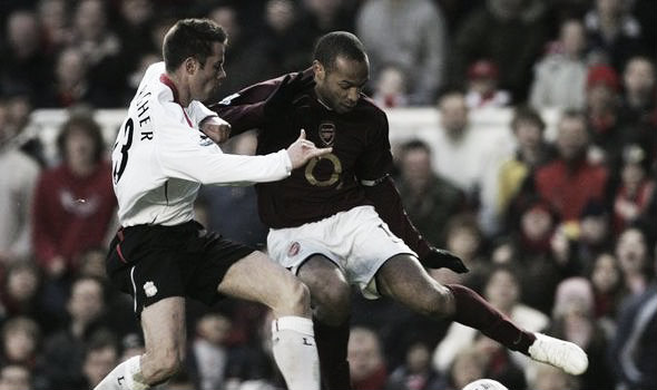 Carragher versus Henry during one of their many battles (image: express.co.uk)
