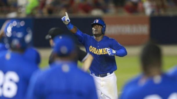 Colombia's Dilson Herrera celebrates after hitting a solo home run in the 8th inning during a World Baseball Classic qualifying championship game against Panama in Panama City, Sunday, March 20, 2016. (AP Photo/Arnulfo Franco)