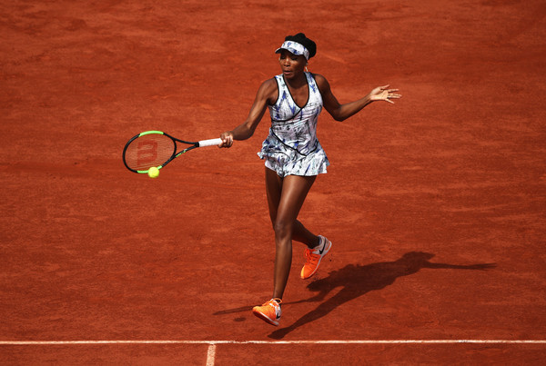 The 2002 French Open runner-up had a solid run to the fourth round (Photo by Julian Finney / Getty)