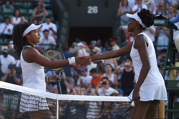 The two players shook hands at the net after a good contest played in good spirits (Photo by Oli Scarff / Getty)