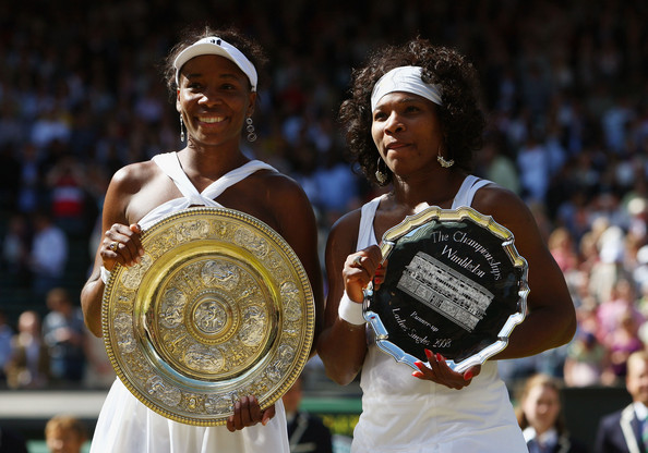 Venus (left) posing with the Venus Rosewater Dish for the fifth time (Photo by Ryan Pierse / Getty Images)
