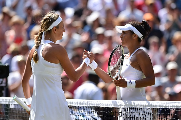 The two players shook hands at the net after a close encounter (Photo by Glyn Kirk / Getty)