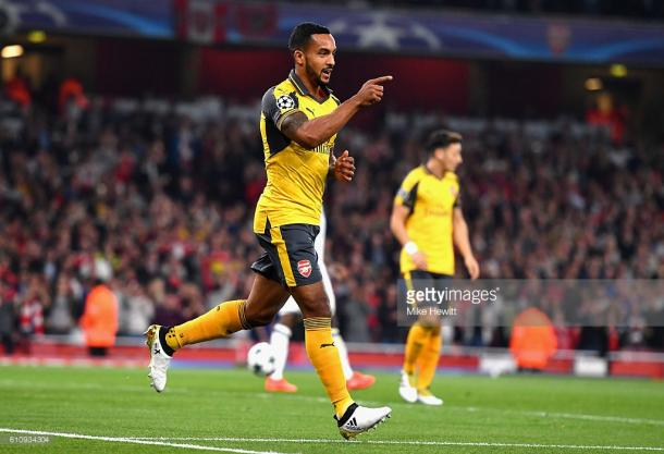Walcott celebrates one of two goals he scored against Basel in the Champions League | Photo: Getty.