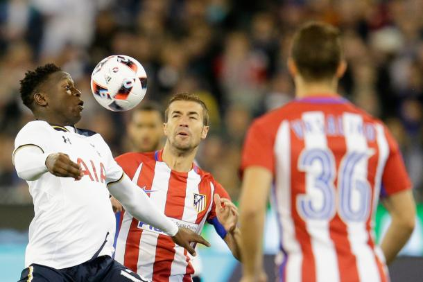 Wanyama battles for possession against Atletico (photo; Getty)