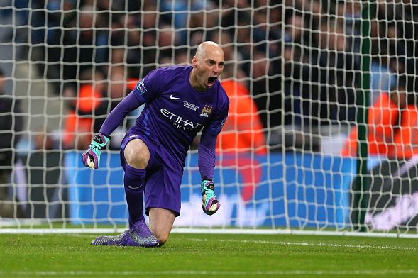 Caballero (pictured) celebrates one of his three penalty saves, helping City to victory dramatically | Photo: Getty