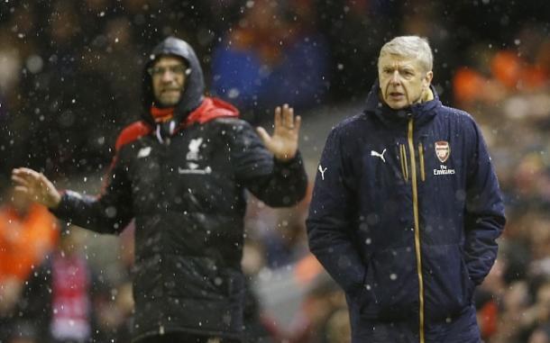 Klopp e Wenger nell'ultimo incontro sotto la pioggia. Fonte foto: telegraph.co.uk