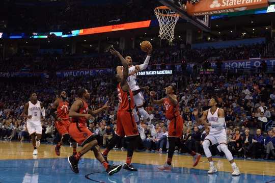 Russell Westbrook drives to the rim as DeMar DeRozan and Terrence Ross defend. PHOTO: Mark D. Smith/USA Today Sports