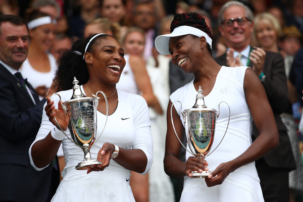 The Williams sisters claimed their sixth Wimbledon doubles title together (Photo by Clive Brunskill / Getty)