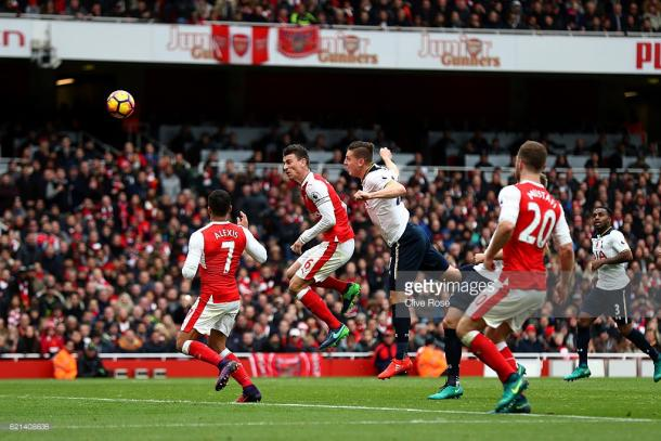 Kevin Wimmer scores an own goal for Arsenals first during the Premier League match between Arsenal and Tottenham Hotspur. | Photo: Clive Rose/Getty Images