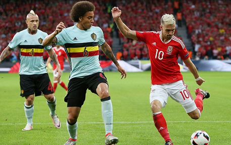 Witsel attempting to block an Aaron Ramsey effort during Belgium's 3-1 defeat against Wales in the quarter-finals. | Photo: GEtty