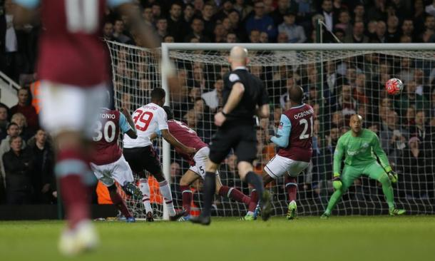 Rashford, 39, launches a clinical curling shot to give United the lead over West Ham. | Source: Tom Jenkins for the Guardian