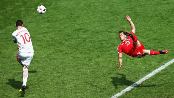 Sumptuous strike: Shaqiri's bicycle kick bounced in off the post, giving Fabianski no chance.   Photo: Getty