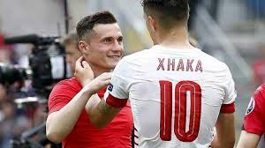 Shirt swap? The Xhaka brothers meet up on the pitch after the game | Image: getty images