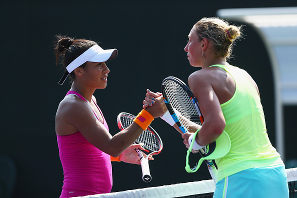 Heather Watson And Yanina Wickmayer Meet At The Net After Their Match. Photo: Clive Brunskill/Getty Images