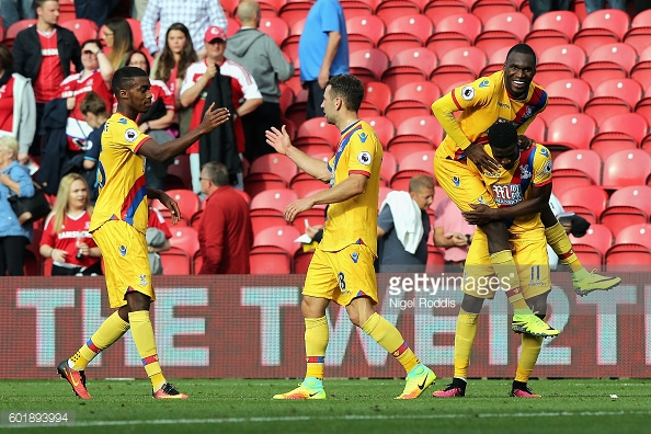 Crystal Palace players celebrate their sides second and deciding goal at the Riverside Stadium   Photo: Getty