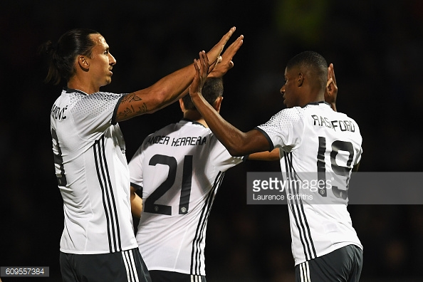 Marcus Rashford celebrating scoring Manchester United's third goal against Northampton with Zlatan Ibrahimovic