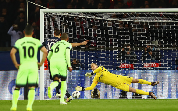 Hart's diving penalty stop to keep the scores level. | Photo: Getty Images