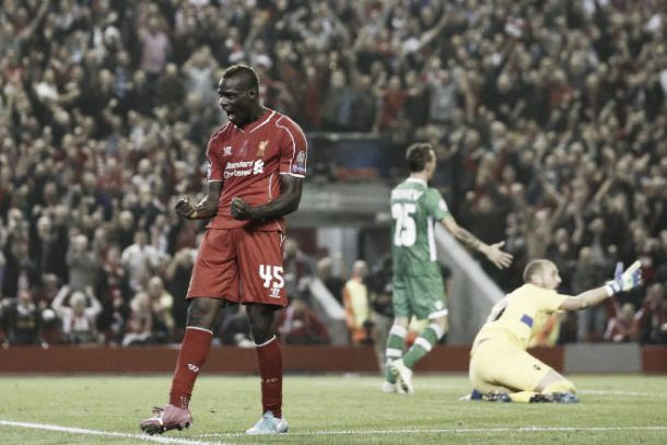 Brendan Rodgers believes Mario Balotelli needs time to meet the demands required of a Liverpool striker