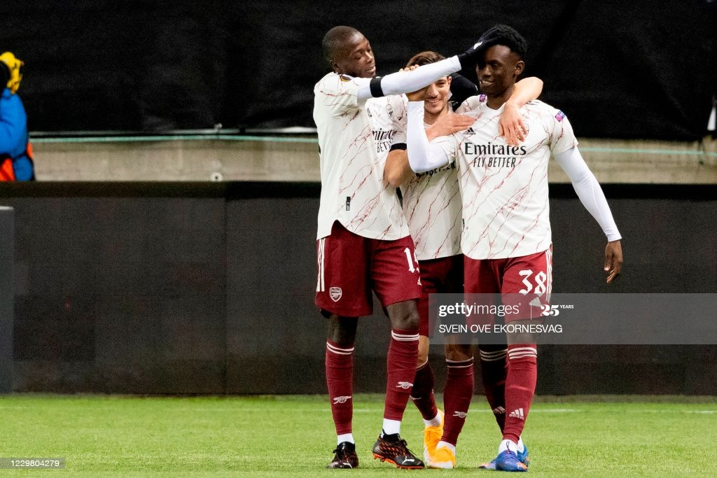 Folarin Balogun (right) celebrates with Arsenal teammates Nicolas Pepe (left) and Cedric Soares (centre) after scoring his first senior goal for the Gunners