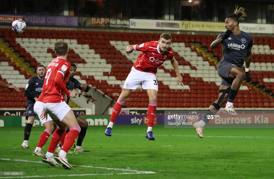 Brentford's Ivan Toney flicks in the winning goal against Barnsley. Photo: George Wood/Getty Images.