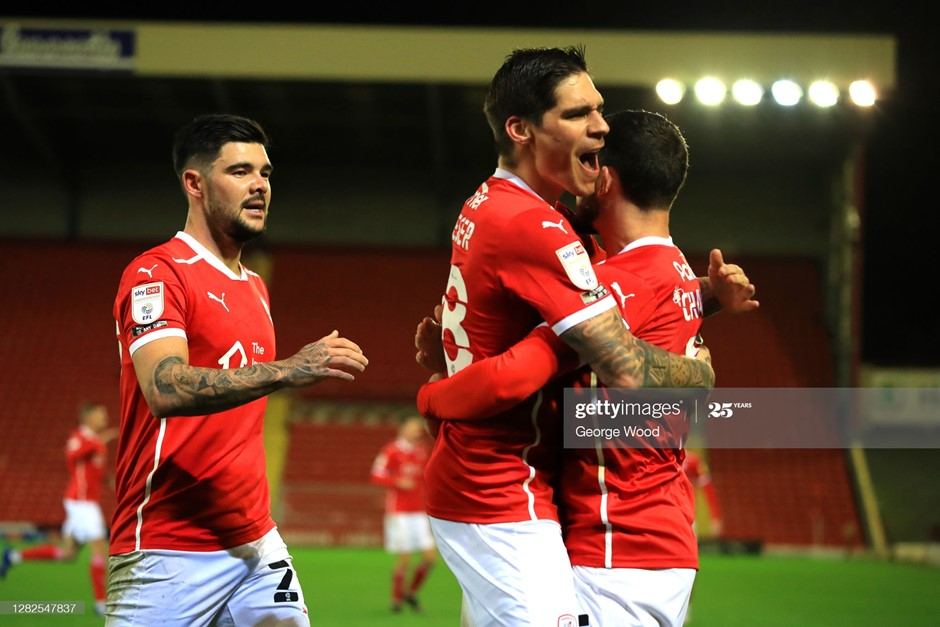 Barnsley's Conor Chaplin (right) celebrates his goal with Alex Mowatt and provider Dominik Frieser. Photo: George Wood/Getty Images.