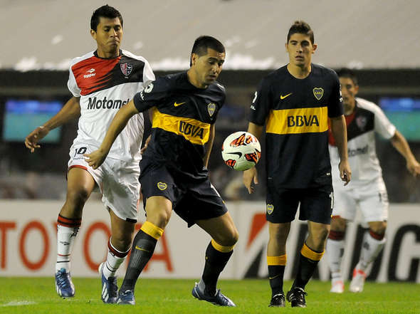 Mesmo dominado pelo Boca, Newell's consegue segurar o empate e decide a vaga em casa