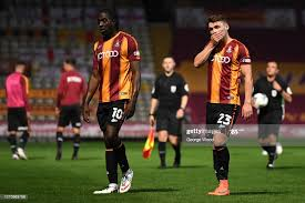 Above: Clayton Donaldson and Connor Wood walk the field of Valley Parade (Source: Getty Images)