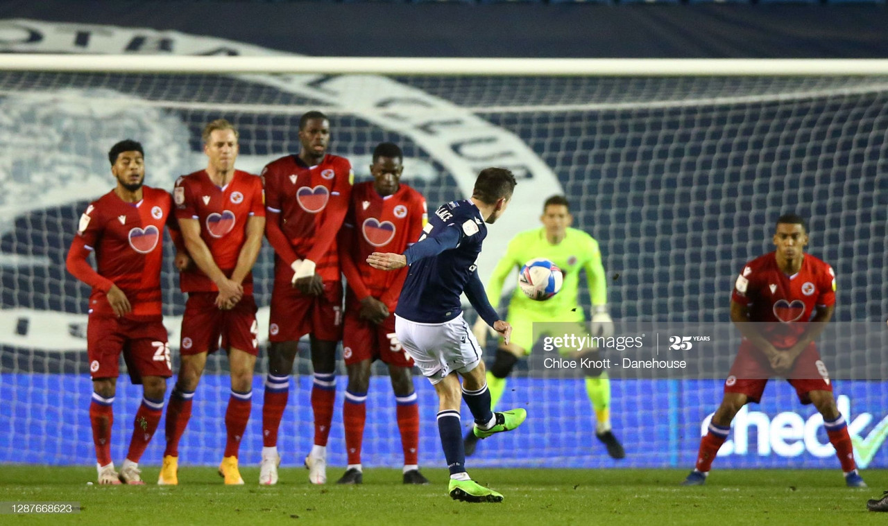 LONDON, ENGLAND - NOVEMBER 25: Jed Wallace of Millwall FC scores his teams first goal from a free kick during the Sky Bet Championship match between Millwall and Reading at The Den on November 25, 2020 in London, England. Sporting stadiums around the UK remain under strict restrictions due to the Coronavirus Pandemic as Government social distancing laws prohibit fans inside venues resulting in games being played behind closed doors. (Photo by Chloe Knott - Danehouse/Getty Images)