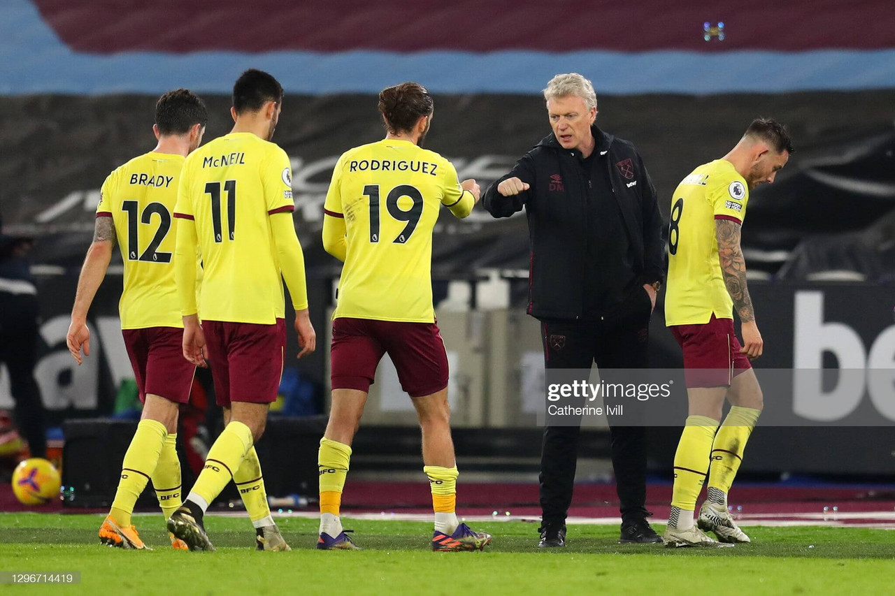 LONDON, ENGLAND - JANUARY 16: David Moyes, Manager of West Ham United interacts with Jay Rodriguez of Burnley after the Premier League match between West Ham United and Burnley at London Stadium on January 16, 2021 in London, England. Sporting stadiums around England remain under strict restrictions due to the Coronavirus Pandemic as Government social distancing laws prohibit fans inside venues resulting in games being played behind closed doors. (Photo by Catherine Ivill/Getty Images)