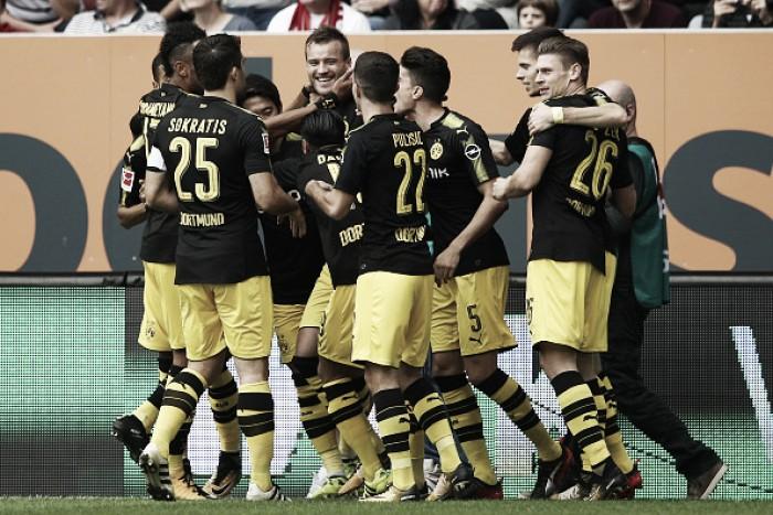 Aubameyang perde pênalti, mas Dortmund supera Augsburg e se mantém na liderança
