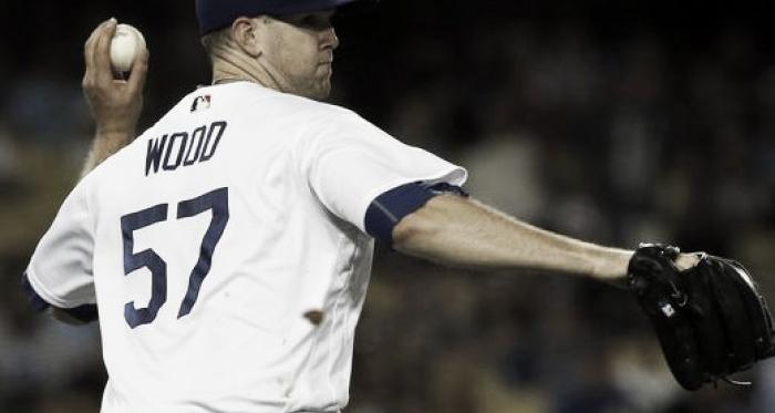 Los Angeles Dodgers pitcher Alex Wood throws to first after fielding a bunt single by Arizona Diamondbacks'Gregor Blanco July 5, 2017. |Source: AP Photo/Alex Gallardo|