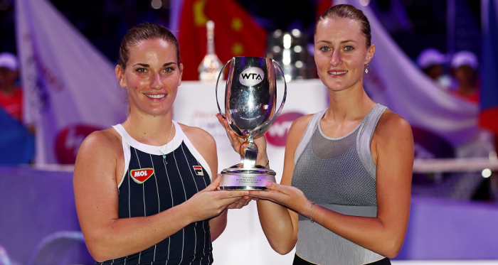 Babos and Mladenovic with their title | Photo: Clive Brunskill