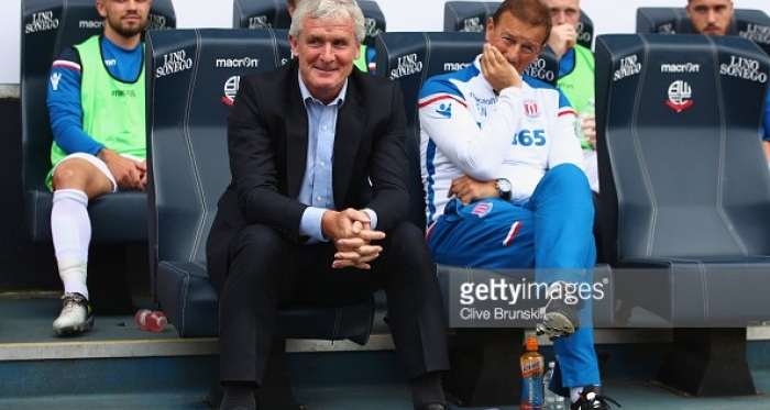 Mark Hughes looks on to Everton for the first game of the Premier League