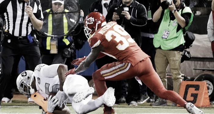 Oakland Raiders wide receiver Michael Crabtree,bottom, catches a touchdown pass in front of Kansas City Chiefs cornerbackTerrance Mitchell (39)  Thursday, Oct. 19, 2017. Source - AP Photo/Ben Margot 