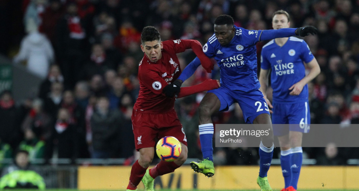 LIVERPOOL, UK. 30 JANUARY. Roberto Firmino of Liverpool battles with Wilfred Ndidi of Leicester City during the Premier League match between Liverpool and Leicester City at Anfield on January 30, 2019 in Liverpool, United Kingdom.(Photo by MI News/NurPhoto via Getty Images)