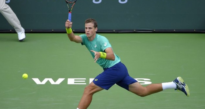 Vasek Pospisil hits a forehand in first round match at Indian Wells. | Photo: BNP Paribas Open