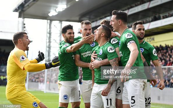 Brighton players celebrating Knockaert's winner. Image courtesy of Harriet Lander from Copa on Getty Images.
