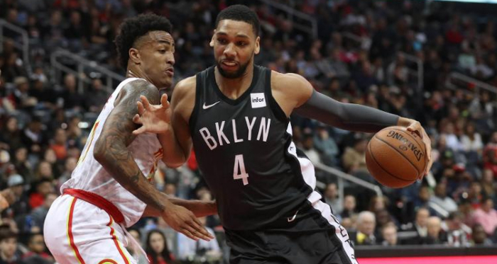 Brooklyn Nets center Jahlil Okafor (4) drives against Atlanta Hawks forward John Collins (20) during the fourth quarter at Philips Arena. |Jason Getz-USA TODAY Sports|