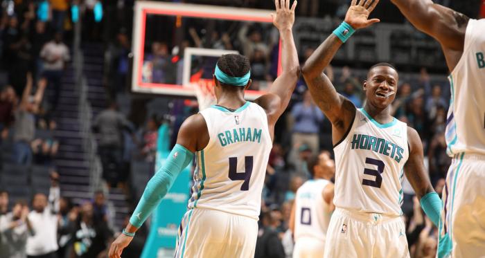 Hornets guards Devonte' Graham (left) and Terry Rozier (right) celebrate.<div>Photo via swarmandsting.com</div>