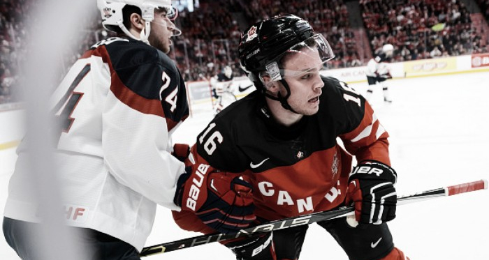 Anthony DeAngelo #24 of Team United States holds back Max Domi #16 of Team Canada in a preliminary round game during the 2015 IIHF World Junior Hockey Championships at the Bell Centre on December 31, 2014 in Montreal, Quebec, Canada. Team Canada