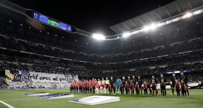 Los jugadores saltan al campo. Fuente: Real Madrid.