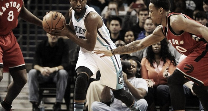 Kemba Walker (right) protects the ball vs. DeMar DeRozan (right) PHOTO: Sam Sharpe/USA Today Sports